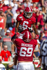 Alabama offensive lineman Landon Dickerson (69) lifts Alabama wide receiver DeVonta Smith (6) to celebrate Smith's touchdown against Mississippi during the first half of an NCAA college football game, Saturday, Sept. 28, 2019, in Tuscaloosa, Ala. (AP Photo/Vasha Hunt)