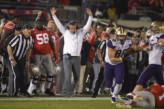 Ohio State coach Urban Meyer celebrates at the team's 28-23 win over Washington during the Rose Bowl NCAA college football game Tuesday, Jan. 1, 2019, in Pasadena, Calif. (AP Photo/Mark J. Terrill)