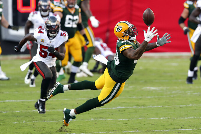 Green Bay Packers tight end Marcedes Lewis (89) misses a pass from quarterback Aaron Rodgers after getting past Tampa Bay Buccaneers inside linebacker Devin White (45) during the first half of an NFL football game Sunday, Oct. 18, 2020, in Tampa, Fla. (AP Photo/Mark LoMoglio)