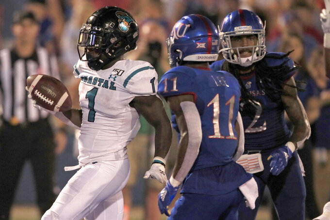 Coastal Carolina running back CJ Marable (1) scores a touchdown past Kansas safety Mike Lee (11) and cornerback Corione Harris (2) during the second half of an NCAA college football game in Lawrence, Kan., Saturday, Sept. 7, 2019. (AP Photo/Orlin Wagner)