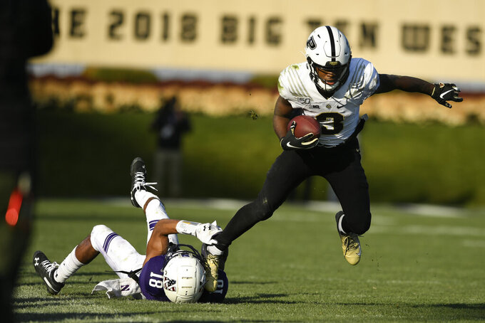 Purdue wide receiver David Bell (3) breaks the tackle of Northwestern cornerback Cam Ruiz (18) during the second half of an NCAA college football game, Saturday, Nov. 9, 2019, in Evanston, Ill. Purdue won 24-22. (AP Photo/Paul Beaty)