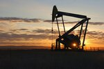 FILE - This Nov. 6, 2013 file photo shows a Whiting Petroleum Co. pump jack pulls crude oil from the Bakken region of the Northern Plains near Bainville, Mont. A federal judge has ruled that the Trump administration's leading steward of public lands has been serving unlawfully and blocked him from continuing in the position. U.S. District Judge Brian Morris said Friday, Sept. 25, 2020, that U.S. Bureau of Land Management acting director William Perry Pendley was never confirmed to the post by the U.S. Senate and served unlawfully for 424 days. Montana's Democratic governor had sued to remove Pendley, saying the the former oil industry attorney was illegally overseeing a government agency that manages almost a quarter-billion acres of land, primarily in the U.S. West. (AP Photo/Matthew Brown, File)