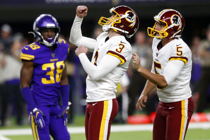Washington Redskins kicker Dustin Hopkins (3) celebrates with teammate Tress Way (5) in front of Minnesota Vikings defensive back Kris Boyd (38) after kicking a 30-yard field goal during the first half of an NFL football game, Thursday, Oct. 24, 2019, in Minneapolis. (AP Photo/Jim Mone)