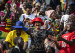 Members of the public sing as they gather in the stands for the funeral service of former president Robert Mugabe at the National Sports Stadium in the capital Harare, Zimbabwe Saturday, Sept. 14, 2019. African heads of state and envoys are gathering to attend a state funeral for Mugabe, whose burial has been delayed for at least a month until a special mausoleum can be built for his remains. (AP Photo/Ben Curtis)
