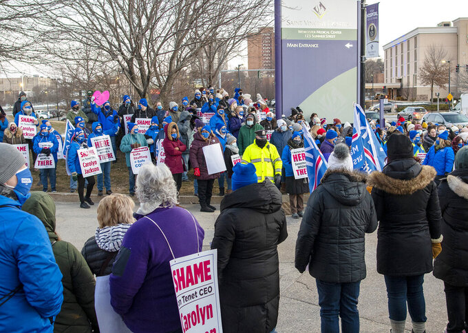 Nurses and members of the Massachusetts Nurses Association gather outside Saint Vincent Hospital in Worcester, Mass., before a strike begins Monday, March 8, 2021. (Rick Cinclair/Worcester Telegram & Gazette via AP)