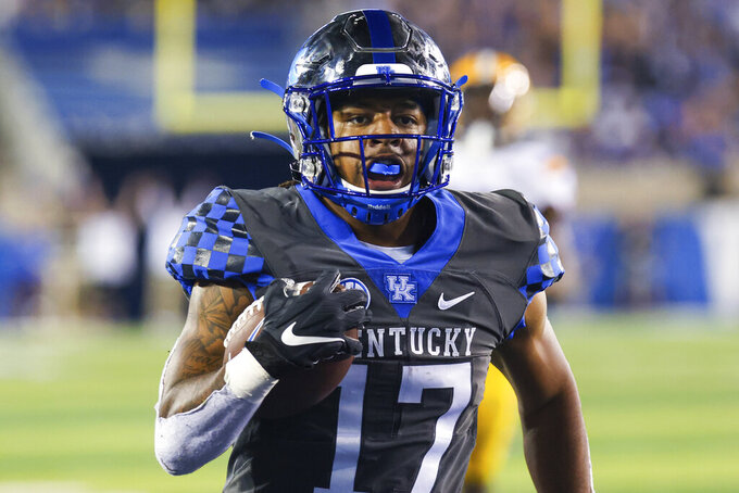 Kentucky running back JuTahn McClain runs the ball into the end zone for a touchdown during the second half of the team's NCAA college football game against LSU in Lexington, Ky., Saturday, Oct. 9, 2021. (AP Photo/Michael Clubb)