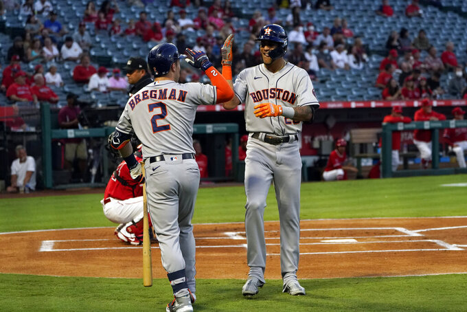 Houston Astros' Jose Siri, right, celebrates his solo home run with Alex Bregman (2) during the first inning of a baseball game against the Los Angeles Angels Monday, Sept. 20, 2021, in Anaheim, Calif. (AP Photo/Marcio Jose Sanchez)