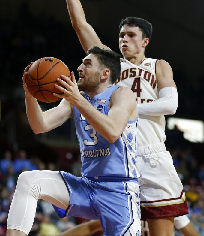 North Carolina's Andrew Platek (3) shoots against Boston College's Chris Herren Jr. (4) during the second half of an NCAA college basketball game in Boston, Tuesday, March 5, 2019. (AP Photo/Michael Dwyer)
