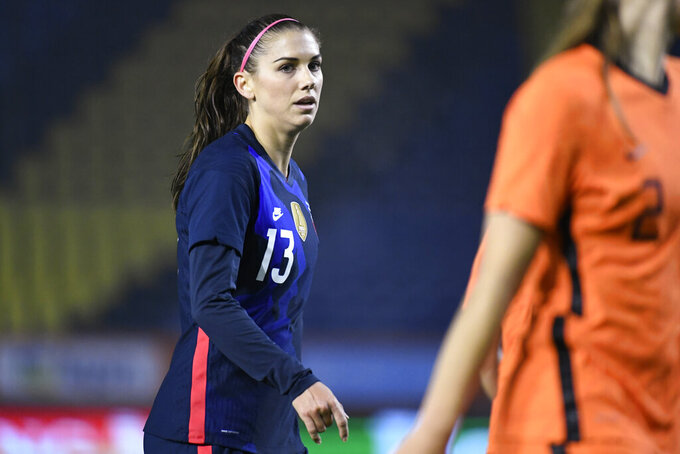 FILE - In this Nov. 27, 2020, file photo, United States Alex Morgan reacts during the international friendly women's soccer match agaiinst The Netherlands at Rat Verlegh stadium in Breda, southern Netherlands. Morgan is back with the U.S. national team and learning to adjust to a career as a working mom. (Piroschka van de Wouw/Pool via AP, File)