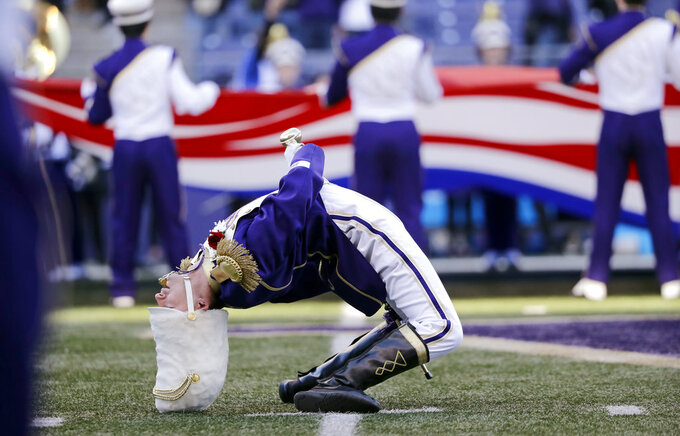 Washington Husky Marching Band drum major Zach Baisch bends backward during the playing of the national anthem before an NCAA college football game against Oregon State, Saturday, Nov. 17, 2018, in Seattle. (AP Photo/Elaine Thompson)