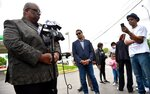 """Darron LaMonte Edwards, left, of United Believers Community Church, talks to the media Tuesday, June 1, 2021, after the family of Malcolm Johnson provided a video of the fatal shooting by police of Johnson at the BP gas station at E. 63rd and Prospect Avenue in March. Faith leaders called it an """"execution."""" Rev. Emanuel Cleaver III of St. James United Methodist Church, center, also spoke. (Jill Toyoshiba/The Kansas City Star via AP)"""