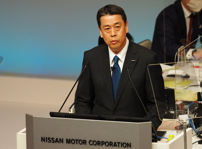 In this photo released by Nissan Motor Co., Nissan Chief Executive Makoto Uchida speaks during a shareholders meeting in Yokohama, near Tokyo, Monday, June 29, 2020. Uchida told shareholders he is giving up half his pay after the Japanese automaker sank into the red amid plunging sales and plant closures in Spain and Indonesia. Uchida apologized for the poor results and promised a recovery by 2023, driven by cost cuts and new models showcasing electric-car and automated-driving technology. (Nissan Motor Co. via AP)