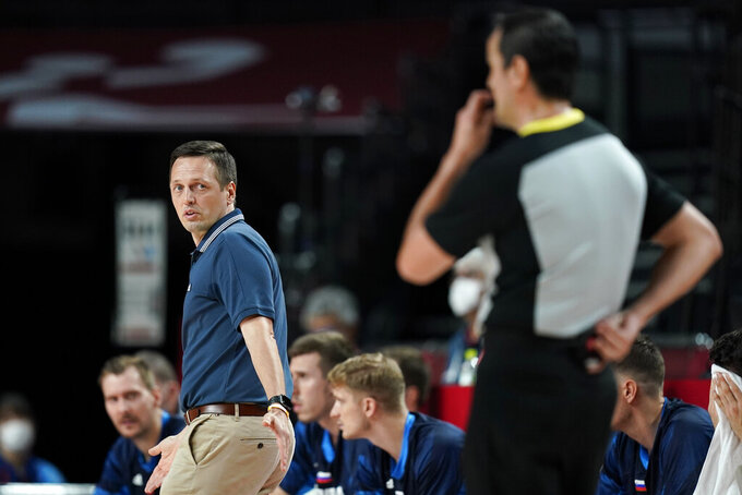 Slovenia head coach Aleksander Sekulic, left, questions a call during a men's basketball semifinal round game against France at the 2020 Summer Olympics, Thursday, Aug. 5, 2021, in Saitama, Japan. (AP Photo/Charlie Neibergall)