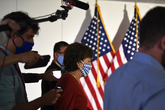 FILE - In this June 9, 2020, file photo Sen. Susan Collins, R-Maine, is followed by reporters as she arrives for the weekly Republican policy luncheon on Capitol Hill in Washington. Collins is once again in a pressure cooker over an issue riveting the nation. This time it's the battle over President Donald Trump's effort to replace the late Justice Ruth Bader Ginsburg on the Supreme Court. (AP Photo/Susan Walsh, File)