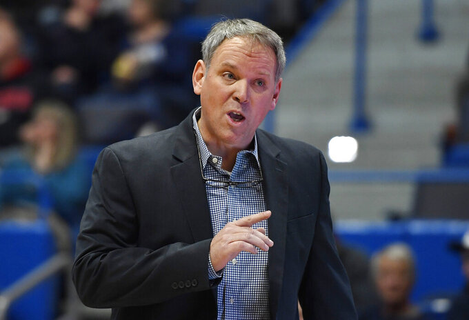 Maine head coach Richard Barron gestures during the first half of an NCAA college basketball game against Connecticut, Sunday, Dec. 1, 2019, in Hartford, Conn. (AP Photo/Jessica Hill)