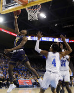 California guard Darius McNeill (1) scores past UCLA guard Jaylen Hands (4) during the first half of an NCAA college basketball game Saturday, Jan. 5, 2019, in Los Angeles. (AP Photo/Marcio Jose Sanchez)