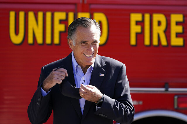 Sen. Mitt Romney, R-Utah, looks on during a news conference Thursday, Oct. 15, 2020, near Neffs Canyon, in Salt Lake City. Romney announced legislation to establish a national wildfire commission that would make policy recommendations aimed at diminishing future wildfire disasters. (AP Photo/Rick Bowmer)