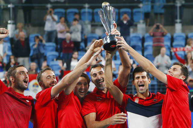 Serbia players hold up the ATP CUP after defeating Spain during their ATP Cup tennis tournament in Sydney, Monday, Jan. 13, 2020. (AP Photo/Steve Christo)