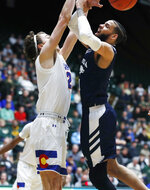 Colorado State forward Logan Ryan, left, blocks a shot by Nevada forward Cody Martin during the first half of an NCAA college basketball game Wednesday, Feb. 6, 2019, in Fort Collins, Colo. (AP Photo/David Zalubowski)