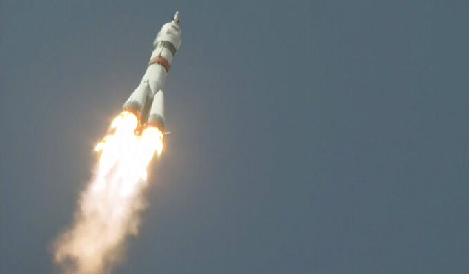 In this photo taken from video footage released by the Roscosmos Space Agency, the Soyuz-2.1a rocket booster with Soyuz MS-18 space ship carrying a new crew to the International Space Station, ISS, flies at the Russian leased Baikonur cosmodrome, Kazakhstan, Friday, April 9, 2021. A Russian-U.S. trio of space travelers have launched successfully, heading for the International Space Station. NASA astronaut Mark Vande Hei and Russian cosmonauts Oleg Novitskiy and Pyotr Dubrov blasted off as scheduled at 12:42 p.m. (0742 GMT, 3:42 a.m. EDT) Friday aboard the Soyuz MS-18 spacecraft from the Russia-leased Baikonur launch facility in Kazakhstan. (Roscosmos Space Agency via AP)