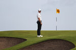 Northern Ireland's Rory McIlroy looks at the bunkers that in front of the 10th green during the first round British Open Golf Championship at Royal St George's golf course Sandwich, England, Thursday, July 15, 2021. (AP Photo/Peter Morrison)