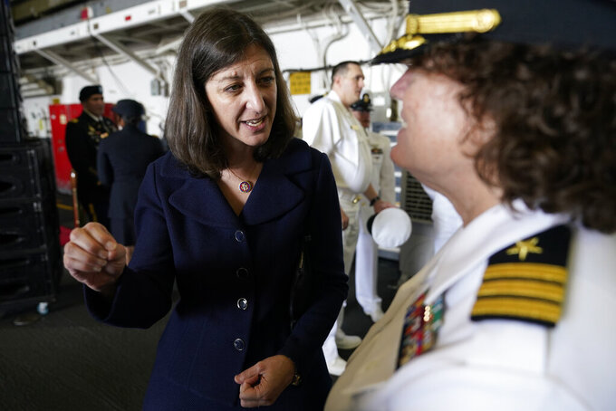 In this July 15, 2021, photo, Rep. Elaine Luria, D-Va., left, speaks to a Naval officer after a ceremony marking full operation of the NATO's Joint force Command aboard the USS Kearsarge at Naval Station Norfolk, in Norfolk, Va. Republicans and Democrats have something in common when it comes to recruiting candidates they hope will deliver majorities in Congress after the 2022 election, and that's military veterans.(AP Photo/Steve Helber)