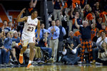 Auburn forward Isaac Okoro (23) celebrates a 3-point shot against Georgia during the first half of an NCAA college basketball game Saturday, Jan. 11 2020, in Auburn, Ala. (AP Photo/Julie Bennett)