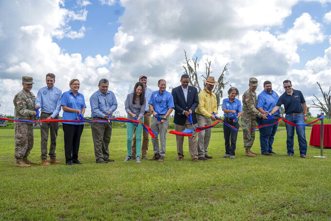 This photo provided by U.S. Army Corps of Engineers shows a ribbon cutting ceremony at at Riverwoods Field Laboratory in Lorida, Fla,, on Thursday, July 29, 2021.    State and federal officials in Florida are marking a major milestone in a 22-year project to restore The Kissimmee River.  (U.S. Army Corps of Engineers via AP)