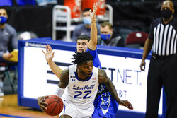 Seton Hall's Myles Cale (22) drives past Creighton's Marcus Zegarowski during the first half of an NCAA college basketball game Wednesday, Jan. 27, 2021, in Newark, N.J. (AP Photo/Frank Franklin II)