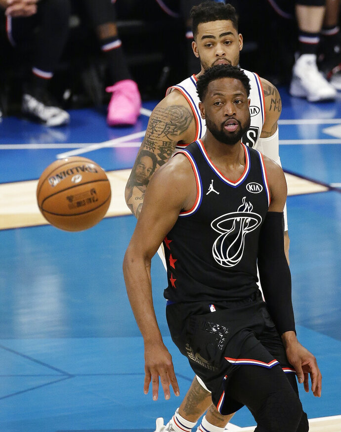 Team LeBron's Dwayne Wade, of the Miami Heat, moves toward the ball against Team Giannis during the first half of an NBA All-Star basketball game, Sunday, Feb. 17, 2019, in Charlotte, N.C. (AP Photo/Gerry Broome)