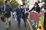 Britain's main opposition Labour Party Shadow Brexit secretary Keir Starmer, 2nd left, is greeted by pro-immigration protesters ahead of a meeting to finalise the manifesto details that will form Labour Party policy for the upcoming General Election in London, Saturday Nov. 16, 2019. Britain's Brexit is one of the main issues for voters and political parties as the UK goes to the polls in a General Election on Dec. 12. (Dominc Lipinski/PA via AP)