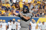 West Virginia quarterback Jarret Doege (2) throws during the first half of an NCAA college football game against Long Island in Morgantown, W.Va., Saturday, Sept., 11, 2021. (AP Photo/Kathleen Batten)