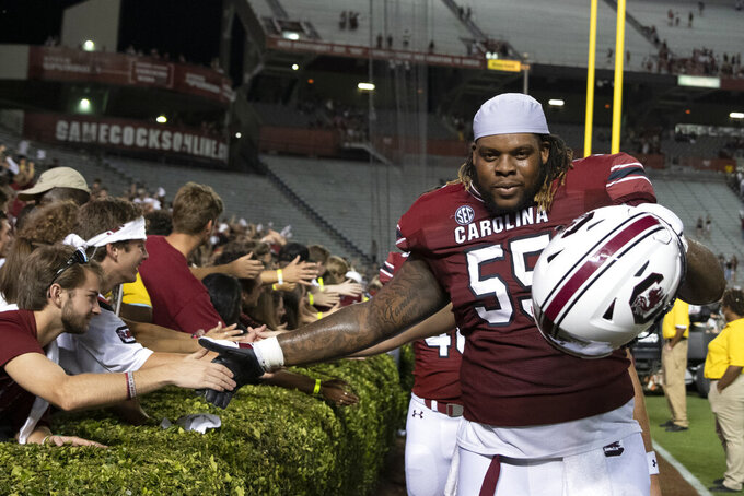 South Carolina offensive lineman Jakai Moore (55) celebrates with fans a victory over Eastern Illinois in an NCAA college football game on Saturday, Sept. 4, 2021, in Columbia, S.C. (AP Photo/Hakim Wright Sr.)