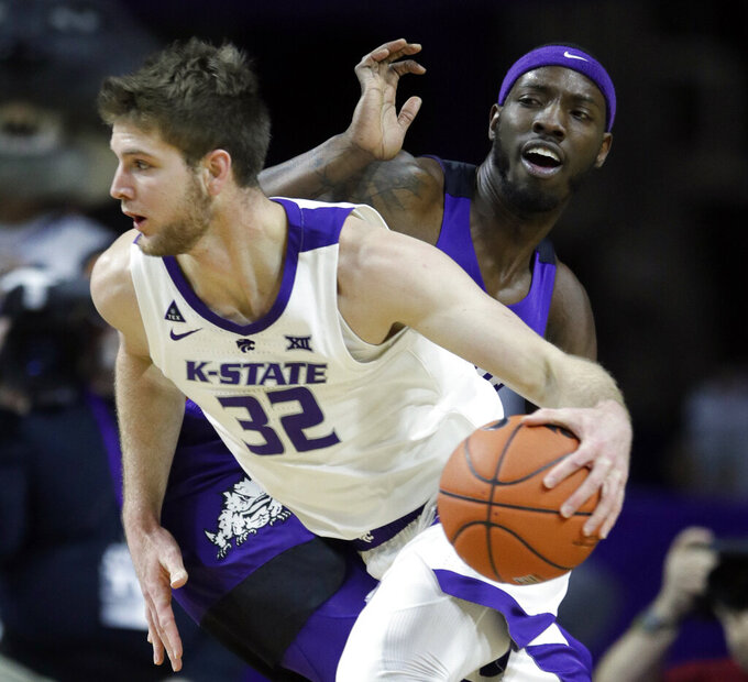 Kansas State forward Dean Wade (32) drives past TCU forward JD Miller, back, during the first half of an NCAA college basketball game in Manhattan, Kan., Saturday, Jan. 19, 2019. (AP Photo/Orlin Wagner)