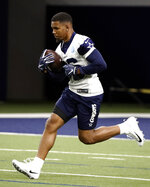 In this Friday, May 10, 2019 photo, Dallas Cowboys rookie running back Tony Pollard (36) participates in drills during a NFL football mini camp at the team's training facility in Frisco, Texas. (AP Photo/Tony Gutierrez)
