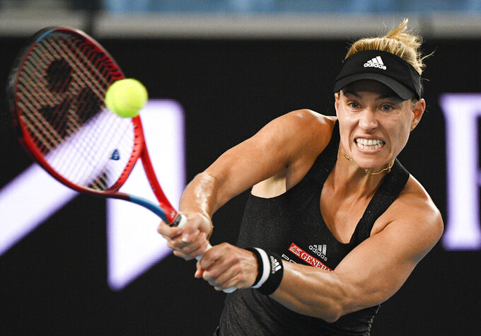 Germany's Angelique Kerber makes a backhand return to Greece's Maria Sakkar during a tuneup event ahead of the Australian Open tennis championships in Melbourne, Australia, Saturday, Feb. 6, 2021.(AP Photo/Andy Brownbill)