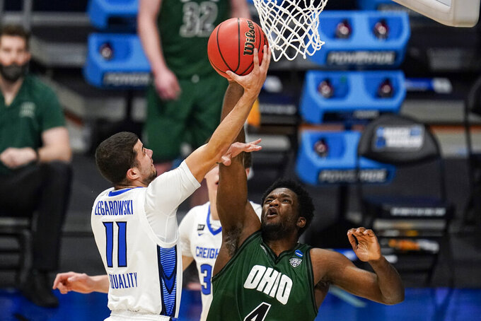 Creighton guard Marcus Zegarowski (11) shoots over Ohio forward Dwight Wilson III (4) in the first half of a second-round game in the NCAA men's college basketball tournament at Hinkle Fieldhouse in Indianapolis, Monday, March 22, 2021. (AP Photo/Michael Conroy)