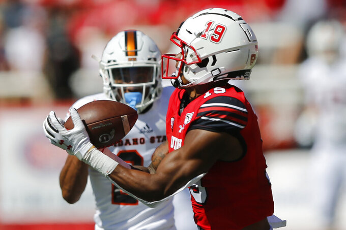 Utah wide receiver Bryan Thompson (19) catches a touchdown pass as Idaho State defensive back Caleb Brown (22) defends in the first half of an NCAA college football game Saturday, Sept. 14, 2019, in Salt Lake City. (AP Photo/Rick Bowmer)
