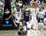 St. Bonaventure's Kyle Lofton, above, falls over Rhode Island's Fatts Russell, below, while fighting for control of the ball during the second half of an NCAA college basketball game in semifinal round of the Atlantic 10 men's tournament Saturday, March 16, 2019, in New York. St. Bonaventure won 68-51. (AP Photo)