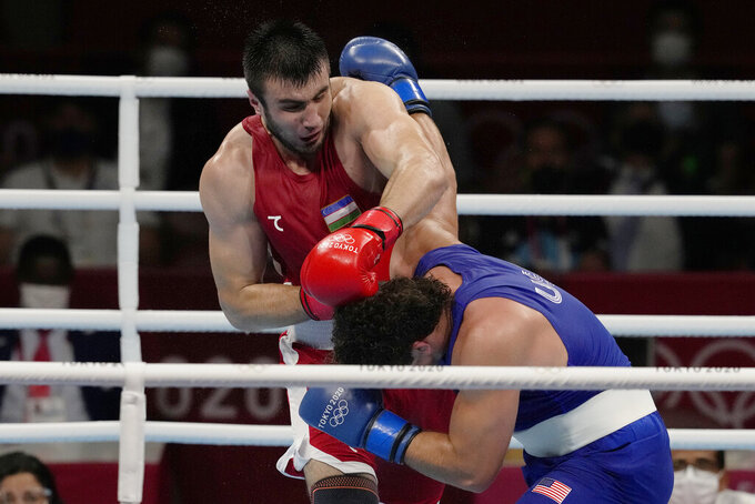 Uzbekistan's Bakhodir Jalalov, top, exchanges punches with Richard Torrez Jr., from the United States during their men's super heavyweight over 91-kg boxing gold medal match at the 2020 Summer Olympics, Sunday, Aug. 8, 2021, in Tokyo, Japan. (AP Photo/Themba Hadebe)