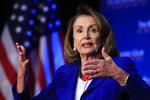 House Speaker Nancy Pelosi of Calif., speaks at an Economic Club of Washington luncheon gathering in Washington, Friday, March 8, 2019. (AP Photo/Manuel Balce Ceneta)