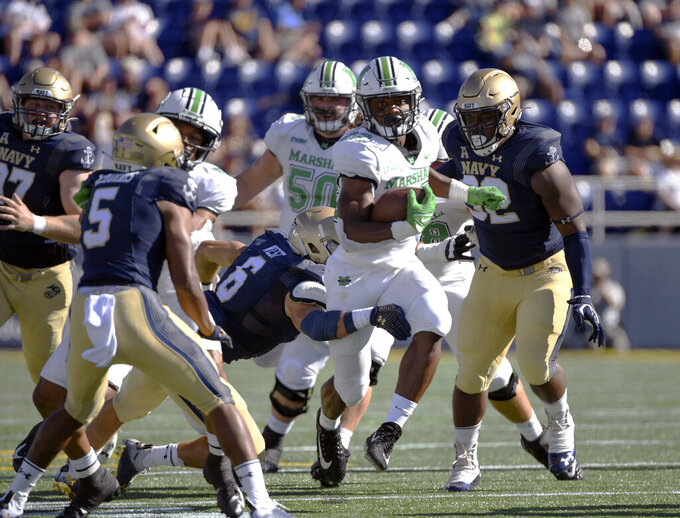 Marshall running back Rasheen Ali (22) runs the ball during the first half of an NCAA college football game against Navy, Saturday, Sept. 4, 2021, in Annapolis, Md. (AP Photo/Terrance Williams)