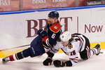 Florida Panthers defenseman Anton Stralman (6) and Chicago Blackhawks defenseman Nikita Zadorov (16) collide as they vie for the puck during the third period of an NHL hockey game, Saturday, March 13, 2021, in Sunrise, Fla. (AP Photo/Wilfredo Lee)