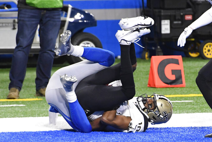 New Orleans Saints wide receiver Tre'Quan Smith falls into the end zone after 2-yard reception for a touchdown during the first half of an NFL football game against the Detroit Lions, Sunday, Oct. 4, 2020, in Detroit. (AP Photo/Jose Juarez)