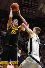 Iowa center Luka Garza (55) shoots over Purdue center Matt Haarms (32) during the first half of an NCAA college basketball game in West Lafayette, Ind., Wednesday, Feb. 5, 2020. (AP Photo/Michael Conroy)