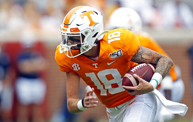 Tennessee quarterback Brian Maurer (18) runs for a touchdown in the second half of an NCAA college football game against Chattanooga, Saturday, Sept. 14, 2019, in Knoxville, Tenn. Tennessee won 45-0. (AP Photo/Wade Payne)