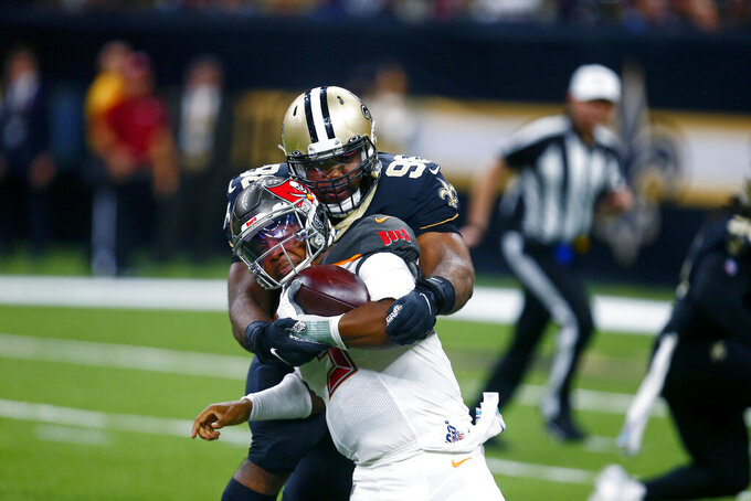 New Orleans Saints defensive tackle Sheldon Rankins (98) sacks Tampa Bay Buccaneers quarterback Jameis Winston (3) in the second half of an NFL football game in New Orleans, Sunday, Oct. 6, 2019. (AP Photo/Butch Dill)