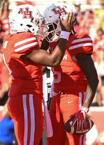 Houston wide receiver Marquez Stevenson, right, celebrates his touchdown with D'Eriq King during the first half of an NCAA college football game against South Florida, Saturday, Oct. 27, 2018, in Houston. (AP Photo/Eric Christian Smith)