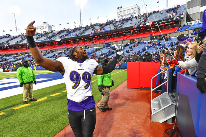Baltimore Ravens outside linebacker Matt Judon (99) celebrates a 24-17 win over the Buffalo Bills after an NFL football game in Orchard Park, N.Y., Sunday, Dec. 8, 2019. (AP Photo/Adrian Kraus)
