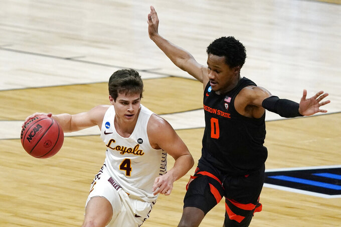 Loyola Chicago guard Braden Norris drives past Oregon State guard Gianni Hunt (0) during the first half of a Sweet 16 game in the NCAA men's college basketball tournament at Bankers Life Fieldhouse, Saturday, March 27, 2021, in Indianapolis. (AP Photo/Jeff Roberson)